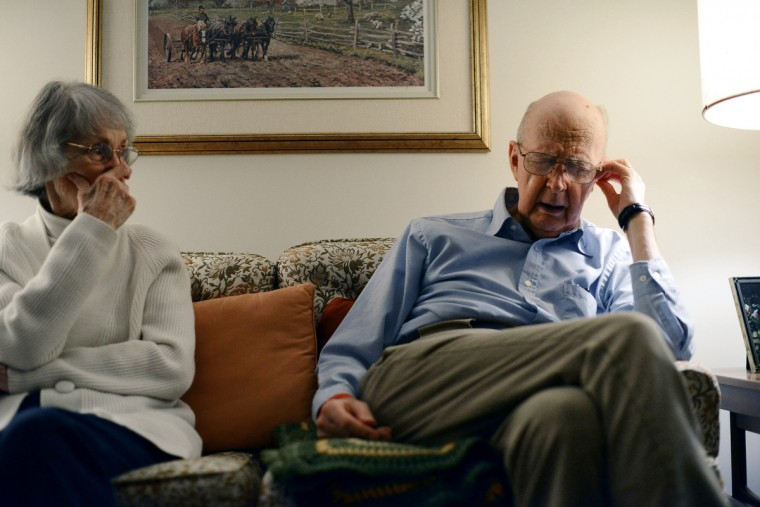 Jan Buckley watches as her husband, Ted Buckley, tries to gather his thoughts as they watch TV. Jan & Ted still live together in their apartment. Rachel Woolf/Baltimore Sun