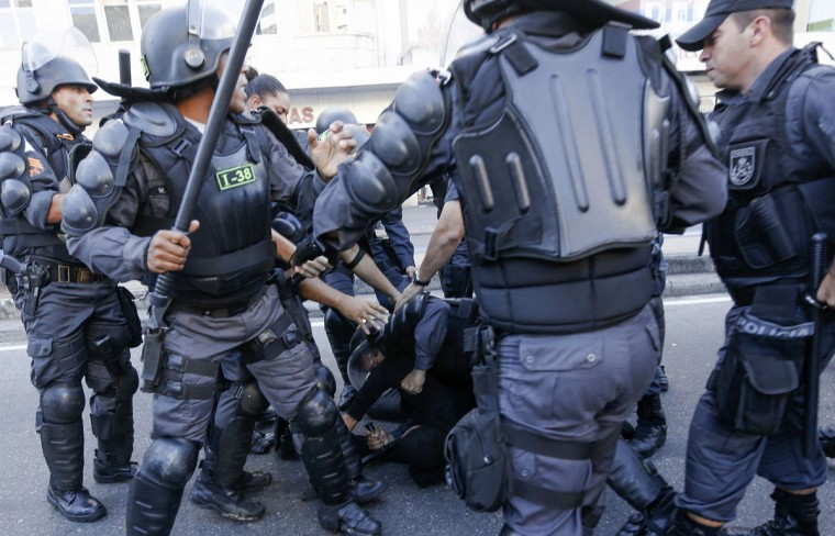 A demonstrator is detained by riot police before the 2014 World Cup final match between Argentina and Germany in Rio de Janeiro. (REUTERS/Marco Bello)