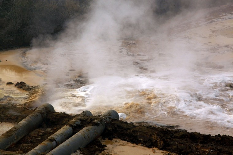 Pipes coming from a rare earth smelting plant spew polluted water into a vast tailings dam near Xinguang Village, located on the outskirts of the city of Baotou in China's Inner Mongolia Autonomous Region in this October 31, 2010 picture. (REUTERS/David Gray)