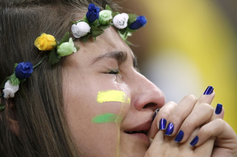 A Brazil fan reacts after the 2014 World Cup third-place playoff between Brazil and the Netherlands at the Brasilia national stadium in Brasilia. (Ueslei Marcelino/Reuters)