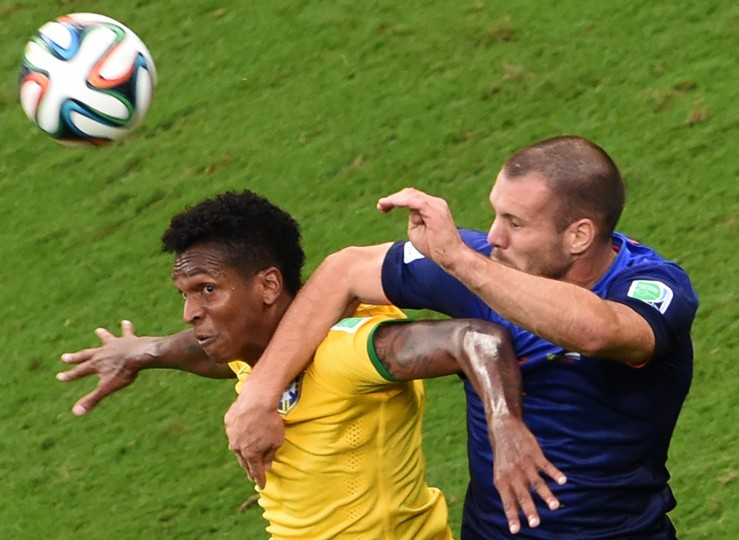 Brazil's forward Jo (L) and Netherlands' defender Ron Vlaar vie for the ball during the third place play-off football match between Brazil and Netherlands during the 2014 FIFA World Cup at the National Stadium. (Evaristo Sa/AFP-Getty Images)