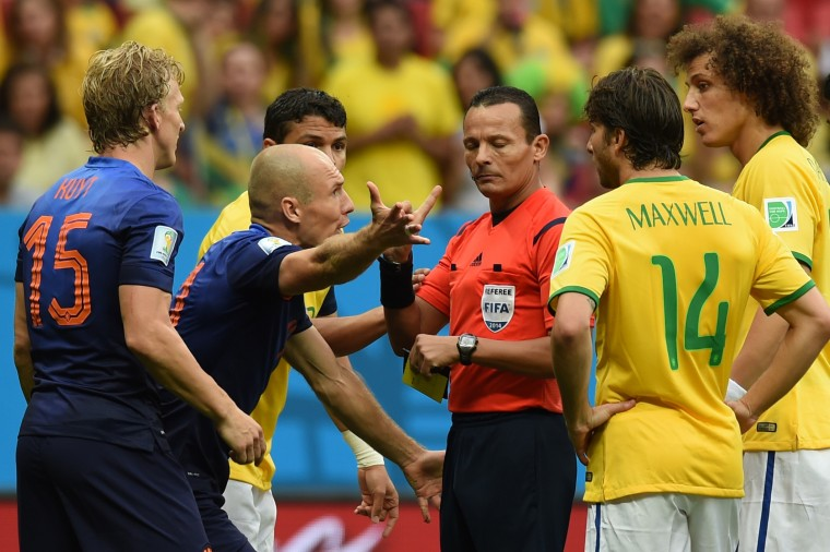 Netherlands' forward Arjen Robben (2nd-L) argues with Algerian referee Djamel Haimoudi (C) before Netherlands was awarded a penalty kick during the third place play-off football match between Brazil and Netherlands during the 2014 FIFA World Cup at the National Stadium in Brasilia. (Vanderlei Almeida/AFP-Getty Images)
