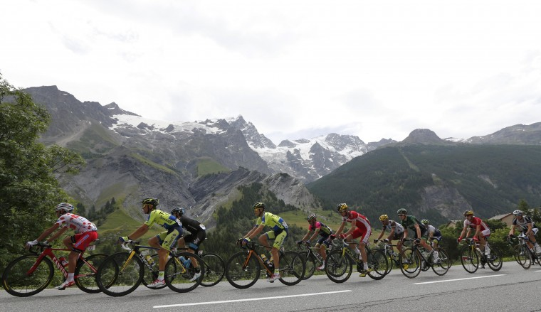 The pack of riders cycles on its way in the Alps mountains during the 177-km fourteenth stage of the Tour de France cycling race between Grenoble and Risoul. (Jean-Paul Pelissier/Reuters)