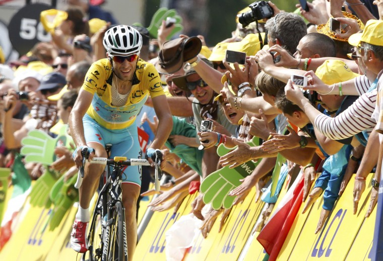 Race leader Astana team rider Vincenzo Nibali (R) of Italy climbs to Risoul during the 177-km fourteenth stage of the Tour de France cycling race between Grenoble and Risoul. (Jacky Naegelen/Reuters)