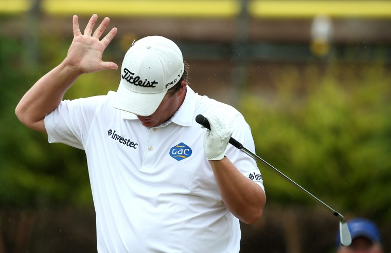 South Africa's George Coetzee reacts on the 8th tee during his third round 74, on day three of the 2014 British Open Golf Championship at Royal Liverpool Golf Course in Hoylake, north west England. (Andrew Yates/AFP-Getty Images)