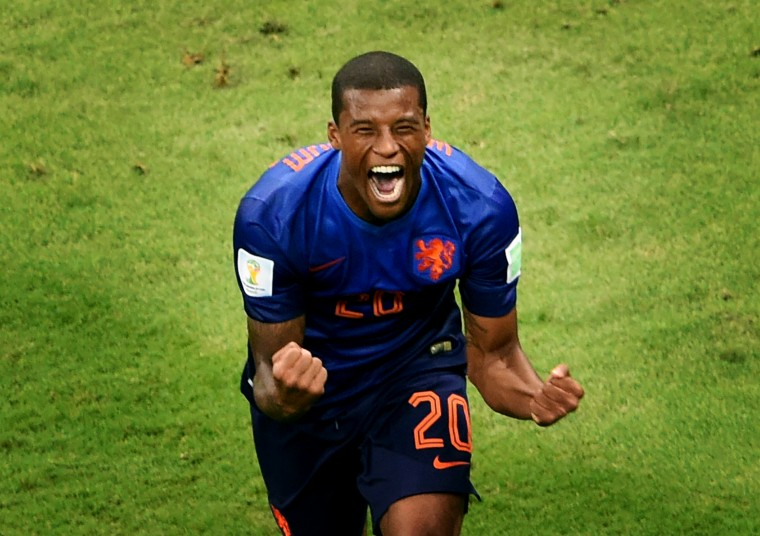 Netherlands' midfielder Georginio Wijnaldum celebrates after scoring a goal during the third place play-off football match between Brazil and Netherlands during the 2014 FIFA World Cup at the National Stadium in Brasilia. (Evaristo Sa/AFP-Getty Images)