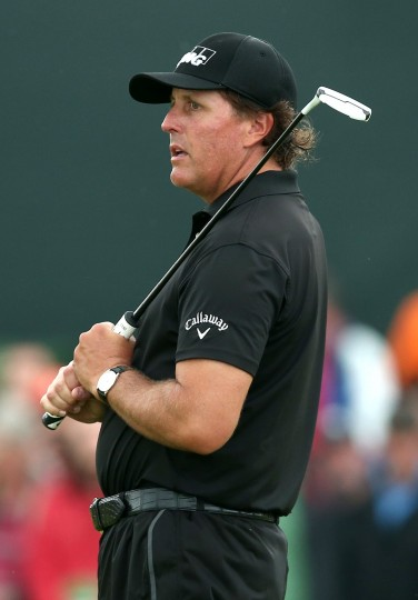 Phil Mickelson, Unites States, stands on the 17th green during his third round, on day three of the 2014 British Open Golf Championship at Royal Liverpool Golf Course in Hoylake, north west England. (andrew Yates/AFP-Getty Images)