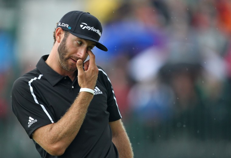 Dustin Johnson, Unites States, reacts to a missed putt on the 8th green during his third round 71, on day three of the 2014 British Open Golf Championship at Royal Liverpool Golf Course in Hoylake, north west England. (Peter Muhly/AFP-Getty Images)