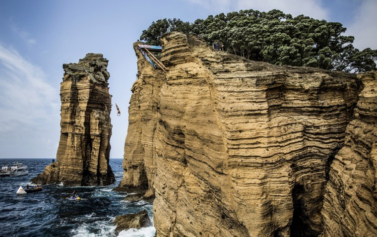 In this handout image provided by Red Bull, David Colturi of the USA dives from the 27 metre platform on Islet Vila Franca do Campo during the fifth stop of the Red Bull Cliff Diving World Series, Azores, Portugal. (Photo by Romina Amato/Red Bull via Getty Images)