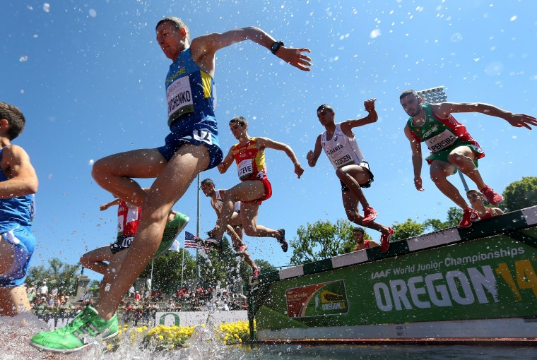 Serhii Shevchenko of Ukraine leads runners over the water pit as they compete in the men's steeplechase heats during day four of the IAAF World Junior Championships at Hayward Field in Eugene, Oregon. (Christian Petersen/Getty Images)