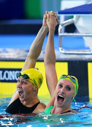 Taylor McKeown (R) of Australia celebrates winning the gold medal with silver medallist Sally Hunter of Australia after the Women's 200m Breaststroke Final at Tollcross International Swimming Centre during day three of the Glasgow 2014 Commonwealth Games in Glasgow, Scotland. (Quinn Rooney/Getty Images)