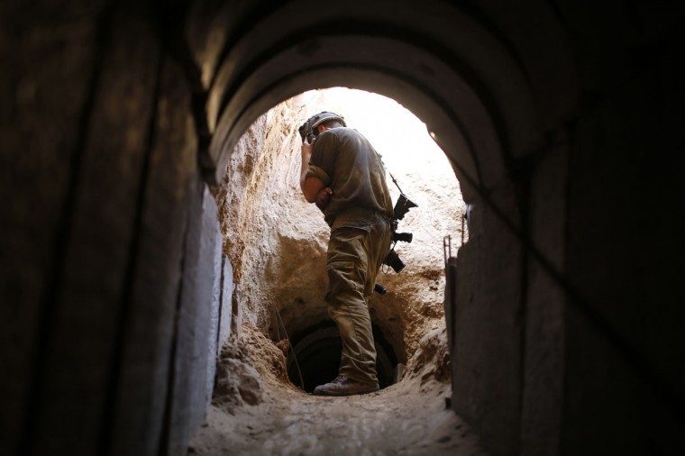 An Israeli soldier looks at a tunnel exposed by the Israeli military near Kibbutz Ein Hashlosha, just outside the southern Gaza Strip on October 13, 2013. (REUTERS/Amir Cohen)