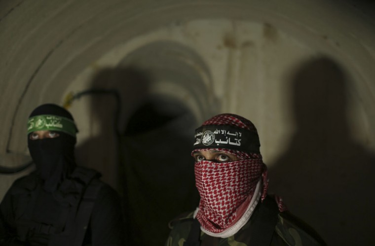 Palestinian fighters from the Izz el-Deen al-Qassam Brigades, the armed wing of the Hamas movement, stand inside an underground tunnel in Gaza on August 18, 2014. (REUTERS/Mohammed Salem)