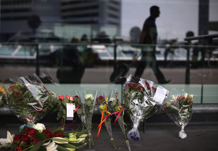 Floral tributes adorn the entrance to Schiphol Airport in memory of the victims of Malaysia flight MH17 on July 18, 2014 in Amsterdam, Netherlands. Air Malaysia flight MH17 travelling from Amsterdam to Kuala Lumpur crashed yesterday on the Ukraine/Russia border near the town of Shaktersk. The Boeing 777 was carrying 298 people including crew members, the majority of the passengers being Dutch nationals, believed to be at least 173, 44 Malaysians, 27 Australians, 12 Indonesians and 9 Britons. It has been speculated that the passenger aircraft was shot down by a surface to air missile by warring factions in the region. (Photo by Christopher Furlong/Getty Images)