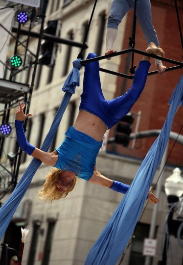 """Greg Bowen, a dancer with Daydreams + Nightmares Aerial Theatre, performs """"Brothers Avienne,"""" at the Aerial Arts Arena at Artscape 2014. (Al Drago/Baltimore Sun)"""