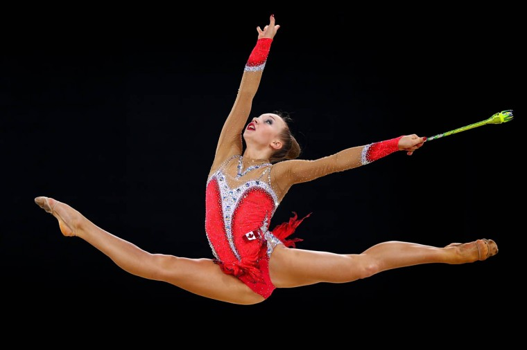 Patrica Bezzoubenko of Canada competes in the Clubs Rotation of the Individual All-Around Rhythmic Gymnastics at the SSE Hydro during day two of the Glasgow 2014 Commonwealth Games on July 25, 2014 in Glasgow, United Kingdom. ( Paul Gilham/Getty Images)