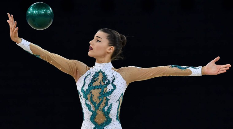 Australia's Danielle Prince competes in the ball discipline, during the Individual All-Around Final of the Rhythmic Gymnastics event at The SSE Hydro venue at the 2014 Commonwealth Games in Glasgow July 25, 2014. (Ben Stansall/Getty Images)