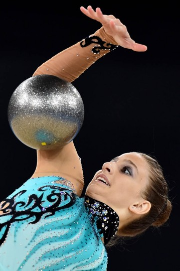 Cyprus's Pantelitsa Theodoulou competes in the ball discipline, during the Individual All-Around Final of the Rhythmic Gymnastics event at The SSE Hydro venue at the 2014 Commonwealth Games in Glasgow July 25, 2014. (Ben Stansall/Getty Images)