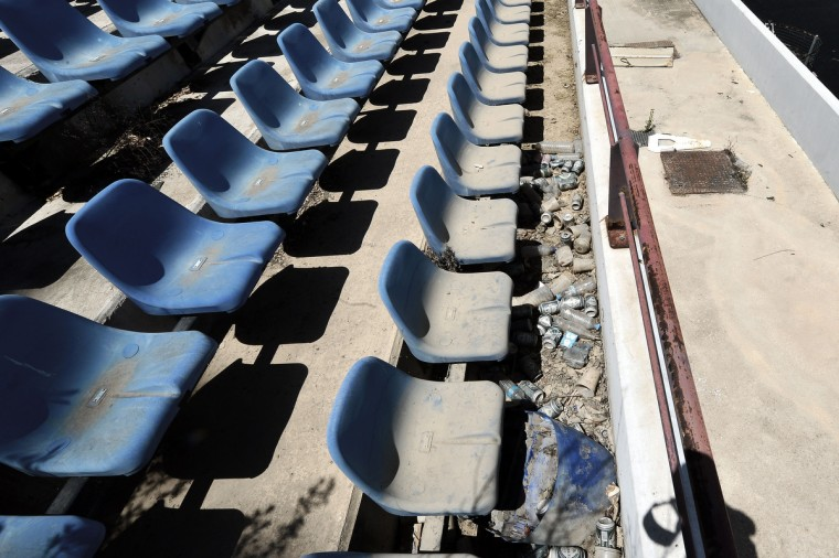 General view of derelict stands at the Olympic Baseball Stadium at the Helliniko Olympic complex in Athens, Greece on July 31, 2014. (Milos Bicanski/Getty Images)