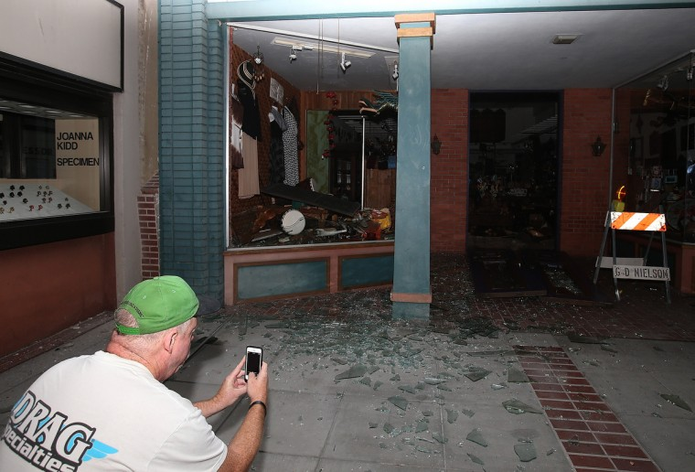 A man takes a picture of a destroyed building following a reported 6.0 earthquake on August 24, 2014 in Napa, California. A 6.0 earthquake rocked the San Francisco Bay Area shortly after 3am on Sunday morning. (Justin Sullivan/Getty Images)