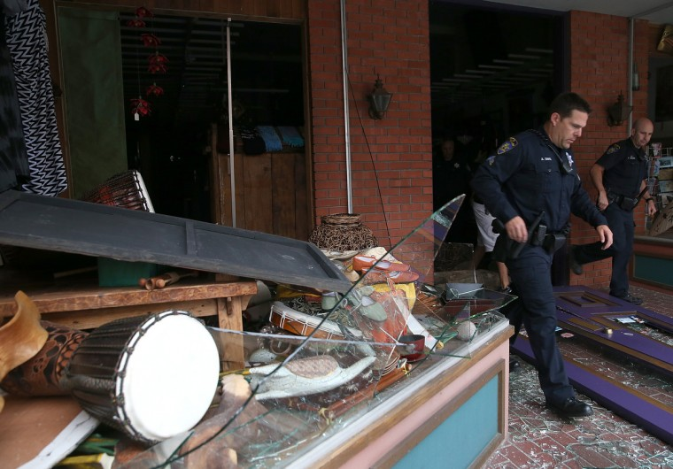Police officers exit a damaged building following a reported 6.0 earthquake on August 24, 2014 in Napa, California. A 6.0 earthquake rocked the San Francisco Bay Area shortly after 3:00 am on Sunday morning causing damage to buildings and sending at least 70 people to a hospital with non-life threatening injuries. (Justin Sullivan/Getty Images)