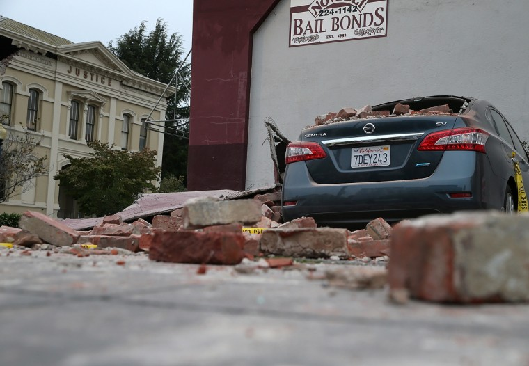 Bricks from a damaged building sit on a car following a reported 6.0 earthquake on August 24, 2014 in Napa, California. A 6.0 earthquake rocked the San Francisco Bay Area shortly after 3:00 am on Sunday morning causing damage to buildings and sending at least 70 people to a hospital with non-life threatening injuries. (Justin Sullivan/Getty Images)