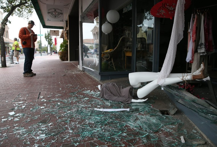 A mannequin lays in broken glass in front of a damaged building following a reported 6.0 earthquake on August 24, 2014 in Napa, California. A 6.0 earthquake rocked the San Francisco Bay Area shortly after 3:00 am on Sunday morning causing damage to buildings and sending at least 70 people to a hospital with non-life threatening injuries. (Justin Sullivan/Getty Images)