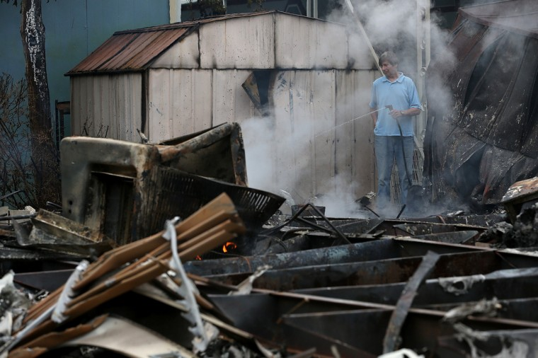 A man uses a garden hose cool hot spots from a fire at a mobile home park following a reported 6.0 earthquake on August 24, 2014 in Napa, California. A 6.0 earthquake rocked the San Francisco Bay Area shortly after 3:00 am on Sunday morning causing damage to buildings and sending at least 70 people to a hospital with non-life threatening injuries. (Justin Sullivan/Getty Images)