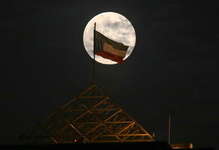 """The """"supermoon"""" is seen rising above the Kuwait skyline on August 10, 2014. The """"supermoon"""" occurs when the moon reaches the closest point to the earth. (Yasser Al-Zayyat/Getty Images)"""