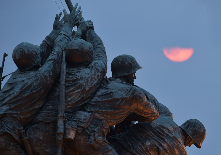 """The perigee moon or """"supermoon"""" rises above the US Marine Corp War Memorial on August 10, 2014 in Arlington, VA. Tonght's supermoon is the largest and closest full moon of the year. It is 14 percent closer and 30 percent brighter than other full moons of the year, according to NASA. (Mandel Ngan/Getty Images)"""
