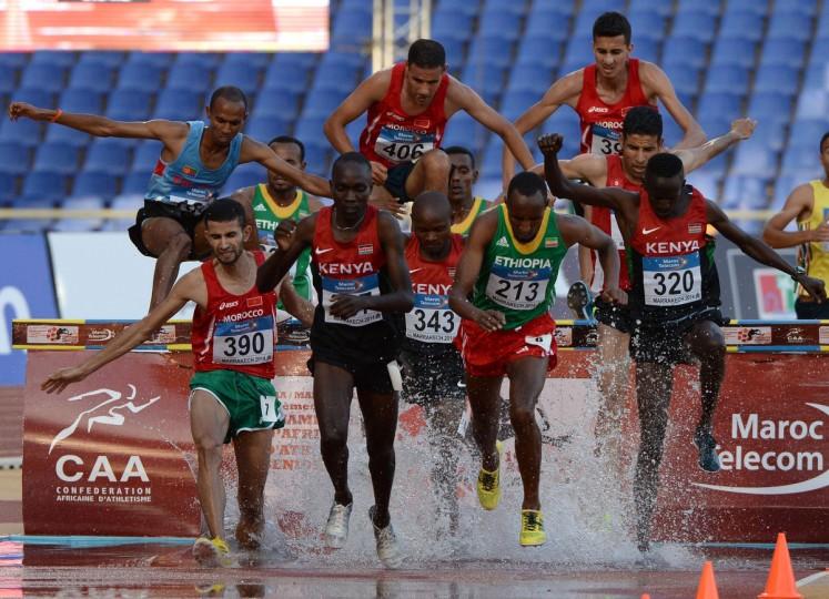 Kenya's Birech Jairus Kipchoge (2L), Kenya's Muia Jonathan Ndiku (3L), Morocco's Chemlal Jaouad (L), Ethiopia's Dette Kemal Nesredin (2R), Kenya's Kamboi Ezekeil (R) compete in the men's 3,000m Steeplechase during the 19th Africa senior Championships in Athletics in Marrakesh. (Fadel Senna/Getty Images)