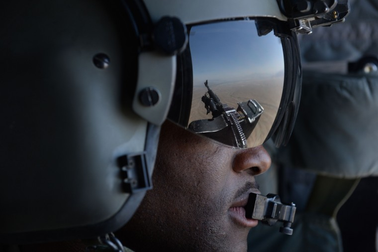 A US soldier, part of the NATO-led International Security Assistance Force (ISAF), mans a machine gun onboard a Chinook helicopter over the Gardez district of Paktia province. All NATO combat troops will be out of Afghanistan by the end of the year, though some US special forces are set to stay on to conduct discreet strikes against Al-Qaeda remanents. (Marai Shah/Getty Images)