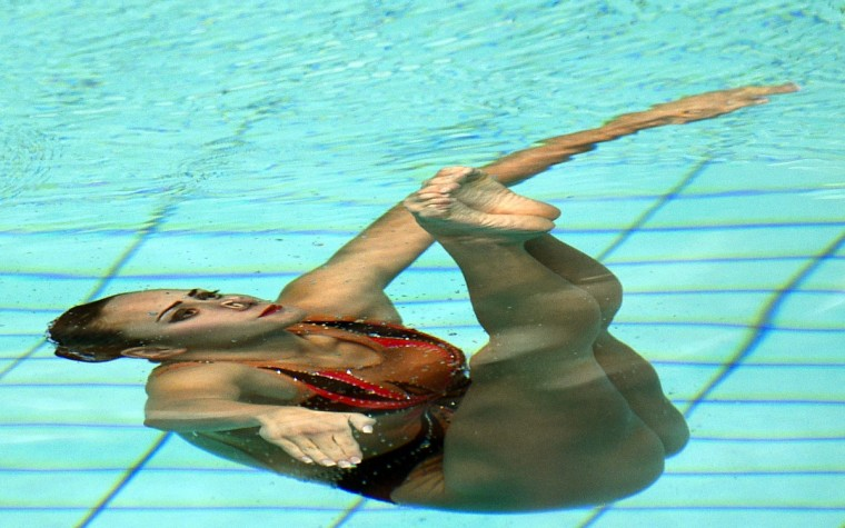 Ukraine's Anna Voloshyna competes to finish third in the synchronized swimming solo technical routine event at the 32nd LEN European Swimming Championships in Berlin. (Damien Meyer/Getty Images)