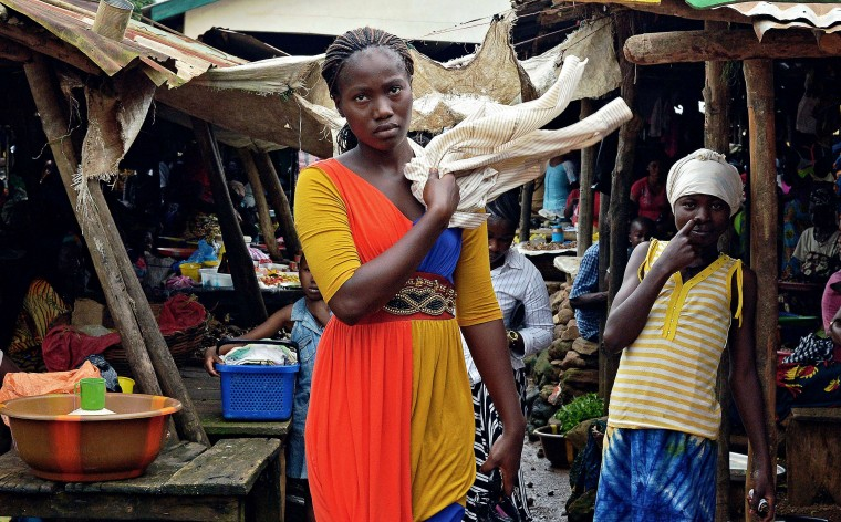 Locals stand at a market in Kenema, Sierra Leone, on August 16, 2014. The death toll from an Ebola outbreak that began at the start of the year stands at 1,145 in four afflicted west African countries: Guinea, Sierra Leone, Liberia and Nigeria. Kailahun, the traditional home of around 30,000 mainly Mende tribespeople, and Kenema account for the lion's share of Sierra Leone's 810 cases and 384 deaths. (Carl De Souza/AFP Getty)