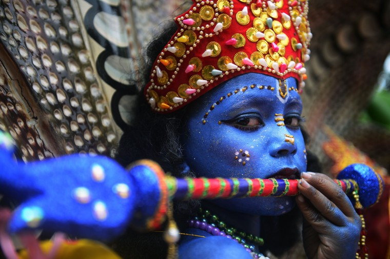 A Bangladeshi youth dressed as the Hindu god Lord Krishna takes part in a procession during celebrations for the Janmashtami festival in Dhaka on August 17, 2014. The Hindu festival of Janmashtami which falls on August 17 in 2014 marks the birth of the Hindu god Lord Krishna. (Munir uz Zaman/AFP Getty)