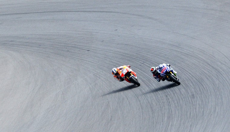 Repsol Honda Team's Spanish rider Dani Pedrosa (L) and Yamaha Factory Racing's Spanish rider Jorge Lorenzo compete during the Moto GP race at Czech Grand Prix on August 17, 2014, in Brno. (Michal Cizek/AFP Getty)