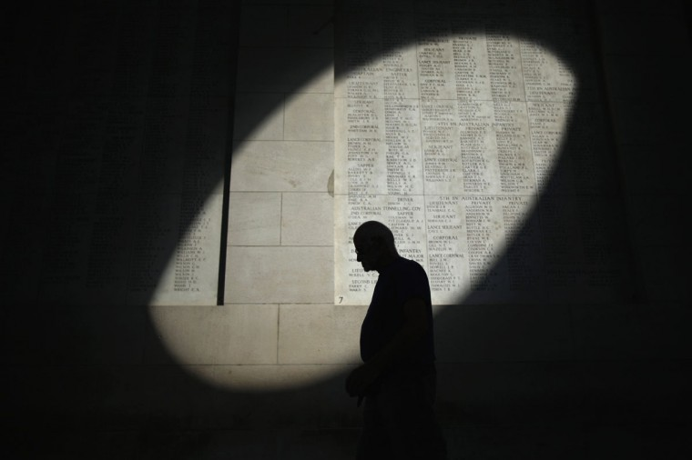 A shaft of sunlight falls on the names of the missing at the Menin Gate Memorial on the centenary of the Great War on August 4, 2014 in Ypres, Belgium. Today marks the 100th anniversary of Great Britain declaring war on Germany. In 1914 British Prime Minister Herbert Asquith announced at 11 pm that Britain was to enter the war after Germany had violated Belgium neutrality. The First World War or the Great War lasted until 11 November 1918 and is recognized as one of the deadliest historical conflicts with millions of causalities. A series of events commemorating the 100th anniversary are taking place throughout the day. (Christopher Furlong/Getty Images)