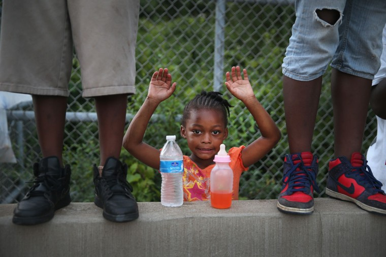 Gabrielle Walker, 5, protests the killing of teenager Michael Brown on August 17, 2014 in Ferguson, Missouri. Despite the Brown family's continued call for peaceful demonstrations, violent protests have erupted nearly every night in Ferguson since his death. (Scott Olson/Getty Images)