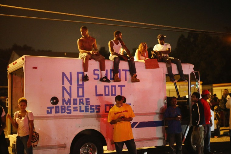 Demonstrators protest the killing of teenager Michael Brown on August 17, 2014 in Ferguson, Missouri. Despite the Brown family's continued call for peaceful demonstrations, violent protests have erupted nearly every night in Ferguson since his death. (Scott Olson/Getty Images)