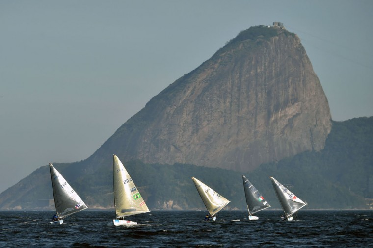Atheletes of Men's Finn class compete during the first day of Aquece Rio, the International Sailing Regatta 2014, as the first test event for the Rio 2016 Olympic and Paralympic Games inside the Guanabara bay in Rio de Janeiro, Brazil, on August 3, 2014. (Yasu Yoshi Chiba/AFP/Getty Images)