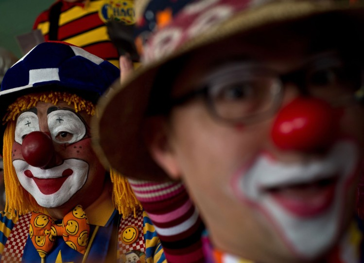 Clowns pose for pictures during a Clown Festival in Kuala Lumpur on August 17, 2014. Around 80 clowns from all over Malaysia took part in the event organized by the Association of Clowns Malaysia to provide a platform for clown education, acquiring new skills and offering members support. (Manan Vatsyayana/AFP/Getty Images)