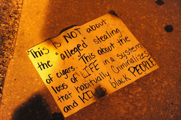 A sign left behind by a protester after a protest on West Florissant Road in Ferguson, Missouri. Riot police late Sunday hurled tear gas and marched on rioters in the St Louis suburb of Ferguson, wracked by race riots since police shot dead an unarmed black teenager. (Michael B. Thomas/AFP/Getty Images)