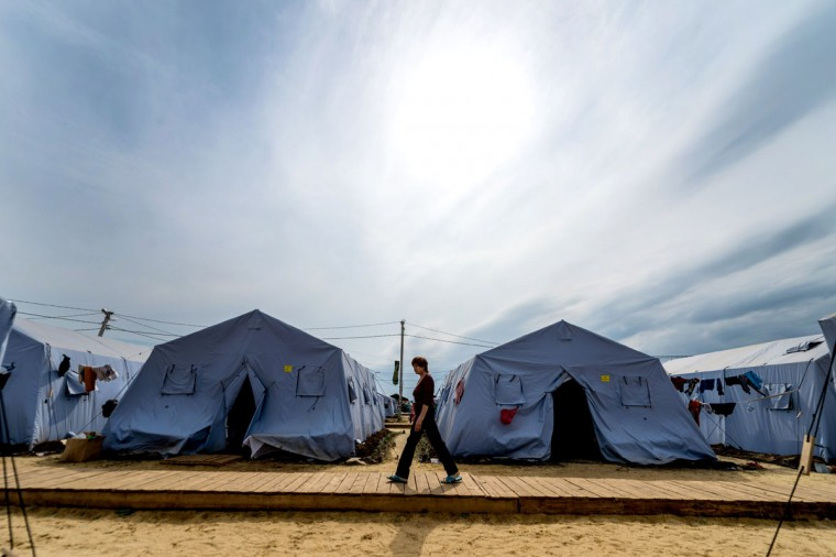 A refugee from eastern Ukraine walks in a refugee camp near the Russian city of Donets'k, Rostov region, about 15 kilometers from the Russian-Ukrainian border. Some 285,000 people have already fled their homes due to the conflict in east Ukraine, it is estimated, with many leaving for other parts of the country, but close to 168,000 seeking sanctuary in Russia. (DMITRY SEREBRYAKOV/AFP/Getty Images)