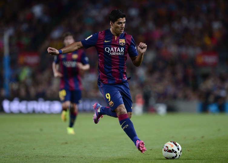 Barcelona's Uruguayan forward Luis Suarez plays during the 49th Joan Gamper Trophy football match FC Barcelona vs Leon Club at the Camp Nou stadium in Barcelona on August 18, 2014. (AFP PHOTO/Getty Images/Jose Plago)