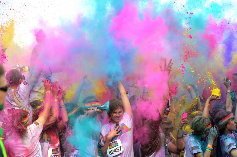 People participate in the annual Color Run in Sydney on August 24, 2014. The Color Run is a 5km fun run which has passed through 30 cities in the US over the past year and has now expanded into the southern hemisphere where as they pass each kilometer marker they are blasted with a different color of harmless paint powder. (Peter Parks/AFP/Getty Images)
