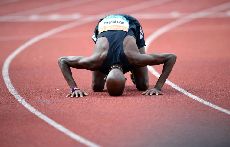 Britain's Mo Farah celebrates after winning the men's 2-mile race during the Diamond League Athletics meeting in Birmingham on August 24, 2014. (CARL COURT/AFP/Getty Images)
