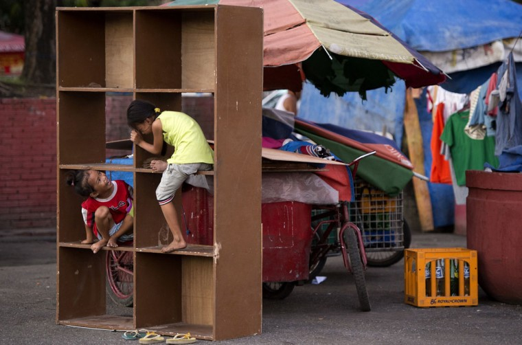 Children play on shelves at a park in Manila on August 24, 2014. (NOEL CELIS/AFP/Getty Images)