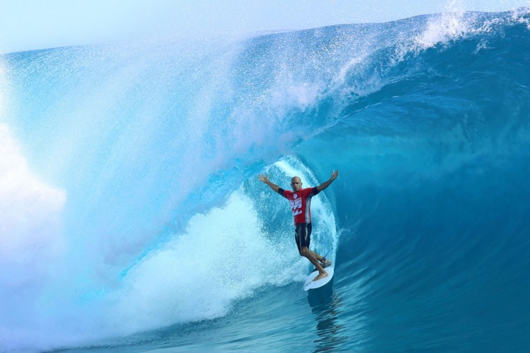 USA's Kelly Slater rides a wave during the third day of the 14th edition of the Billabong Pro Tahiti surf event, part of the ASP (Association of Surfing Professionals) world tour, on August 24, 2014 in Teahupoo, on the French Polynesian island of Tahiti. (GREGORY BOISSY/AFP/Getty Images)