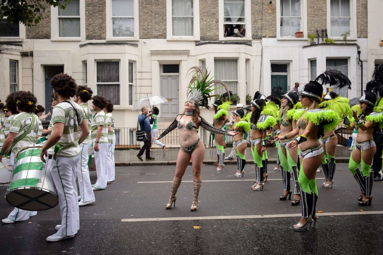 Performers in a costume take part in the parade on the second day of the Notting Hill Carnival in London on August 25, 2014. (LEON NEAL/AFP/Getty Images)