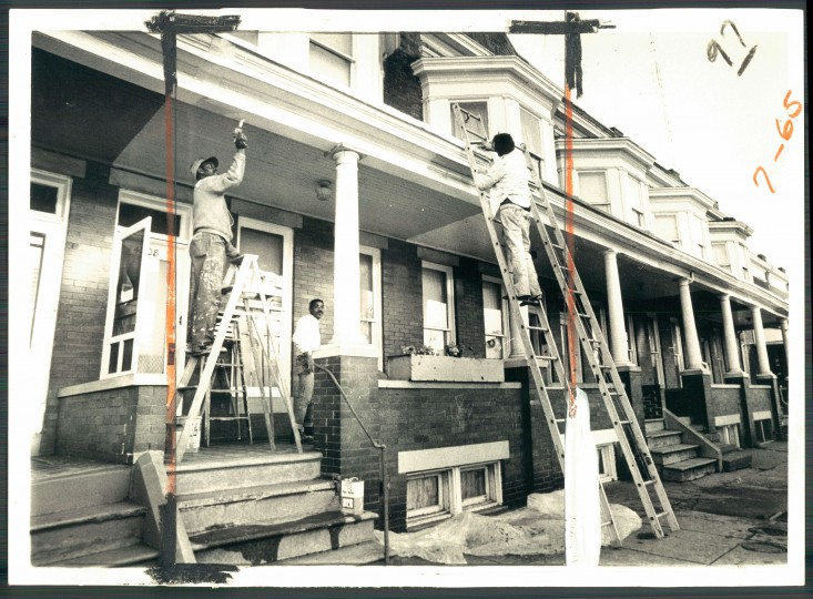Housepainters at work on a rowhouse in the 4200 block of Park Heights Avenue. (Baltimore Sun file/1972)